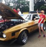 Rich Moore's niece with his award-winning 1972 Gold Glow Mach 1