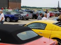 Cars in front of hangar